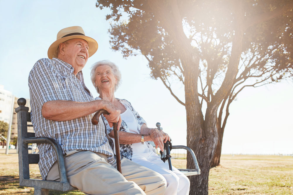 Female and Male Senior Memory Care Residents sitting outside