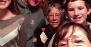 Charter Senior Living of Woodholme Crossing Video Thumbnail Family Group Surrounded by senior living resident